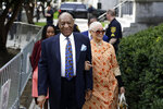 FILE - In this April 24, 2018, file photo, Bill Cosby, left, arrives with his wife, Camille Cosby, for his sexual assault trial at the Montgomery County Courthouse in Norristown, Pa. Cosby was convicted of sexual assault in 2018. He is serving up to 10 years in prison. Now in the midst of another historic reckoning, this time addressing the treatment of African Americans and other people of color by police and the criminal justice system, the 82-year-old Cosby has won the right to an appeal. (AP Photo/Matt Slocum, File)