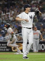 New York Yankees' Brady Lail, foreground, reacts as Baltimore Orioles' Hanser Alberto runs the bases after hitting a three-run home run during the seventh inning of the second game of a baseball doubleheader Monday, Aug. 12, 2019, in New York. (AP Photo/Frank Franklin II)