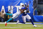 Miami Dolphins cornerback Jomal Wiltz (33) stops New York Giants wide receiver Sterling Shepard (87) in the second half of an NFL football game, Sunday, Dec. 15, 2019, in East Rutherford, N.J. (AP Photo/Adam Hunger)