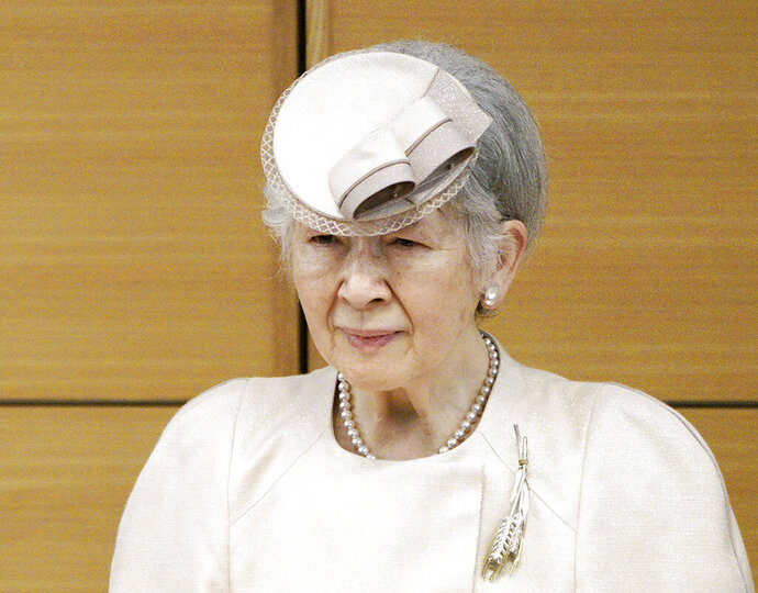 FILE - In this April 26, 2019, file photo, then Japan's Empress Michiko attends the award ceremony of the Midori Academic Prize, in Tokyo. Japanese palace officials say former Empress Michiko has a breast cancer and will have an operation. The Imperial Household Agency said Friday, Aug. 9, 2019, that doctors found Michiko has an early stage of breast cancer that was initially found in a health check in July. (AP Photo/Eugene Hoshiko, Pool, File)