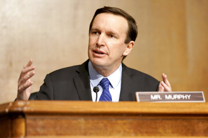 """FILE - Sen. Chris Murphy, D-Conn., speaks on Capital Hill in Washington, in this March 23, 2021, file photo. An Associated Press survey of Division I athletic directors found 69% said they would strongly oppose """"being required to give college athletes a share of university revenue derived from sports.""""""""College sports revenues have exploded exponentially in the last 15 years, but none of that money has gone to the actual players. To act like the sky will fall if athletes receive a fair share of the money their labor produces is downright disingenuous and fails to acknowledge the major civil rights inequities inherent in the industry,"""" Sen. Chris Murphy (D-Conn.) said in a statement to the AP. (Greg Nash/Pool via AP)"""