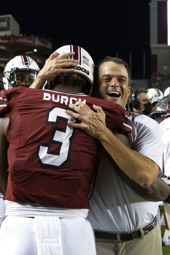 South Carolina defensive end Jordan Burch (3) celebrates with head coach Shane Beamer after his pick six during the second half of an NCAA college football game against Eastern Illinois, Saturday, Sept. 4, 2021, in Columbia, S.C. (AP Photo/Hakim Wright Sr.)