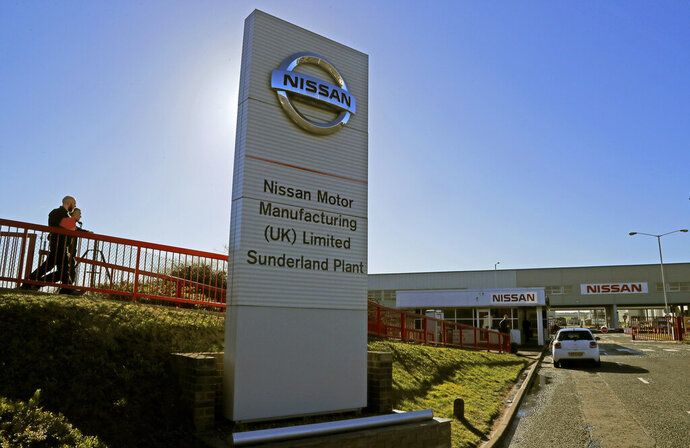 "FILE - In this Thursday, March 14, 2019 file photo, workers walk toward the car builders Nissan plant in Sunderland, England. Japanese carmaker Nissan confirmed Friday, Jan. 22, 2021, that it will maintain its operations in Britain in the wake of the post-Brexit trade deal between the country and the European Union. The news was greeted by British Prime Minister Boris Johnson as a ""great vote of confidence."" (AP Photo/Frank Augstein, File)"