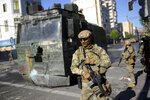 Soldiers patrol the streets of Valparaiso, Chile, Thursday, Oct. 24, 2019. A new round of clashes broke out Thursday as demonstrators returned to the streets, dissatisfied with economic concessions announced by the government in a bid to curb a week of deadly violence. (AP Photo/Matias Delacroix)