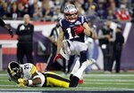 Pittsburgh Steelers defensive back Kameron Kelly, below, tackles New England Patriots wide receiver Julian Edelman after a pass reception in the first half an NFL football game, Sunday, Sept. 8, 2019, in Foxborough, Mass. (AP Photo/Elise Amendola)