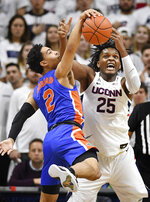 Florida's Andrew Nembhard, left, pulls down a rebound against Connecticut's Josh Carlton during the first half of an NCAA college basketball game Sunday, Nov. 17, 2019, in Storrs, Conn. (AP Photo/Jessica Hill)