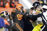 Cleveland Browns defensive end Myles Garrett, left, gets ready to hit Pittsburgh Steelers quarterback Mason Rudolph, second from left, with a helmet during the second half of an NFL football game, Thursday, Nov. 14, 2019, in Cleveland. (AP Photo/Ron Schwane)