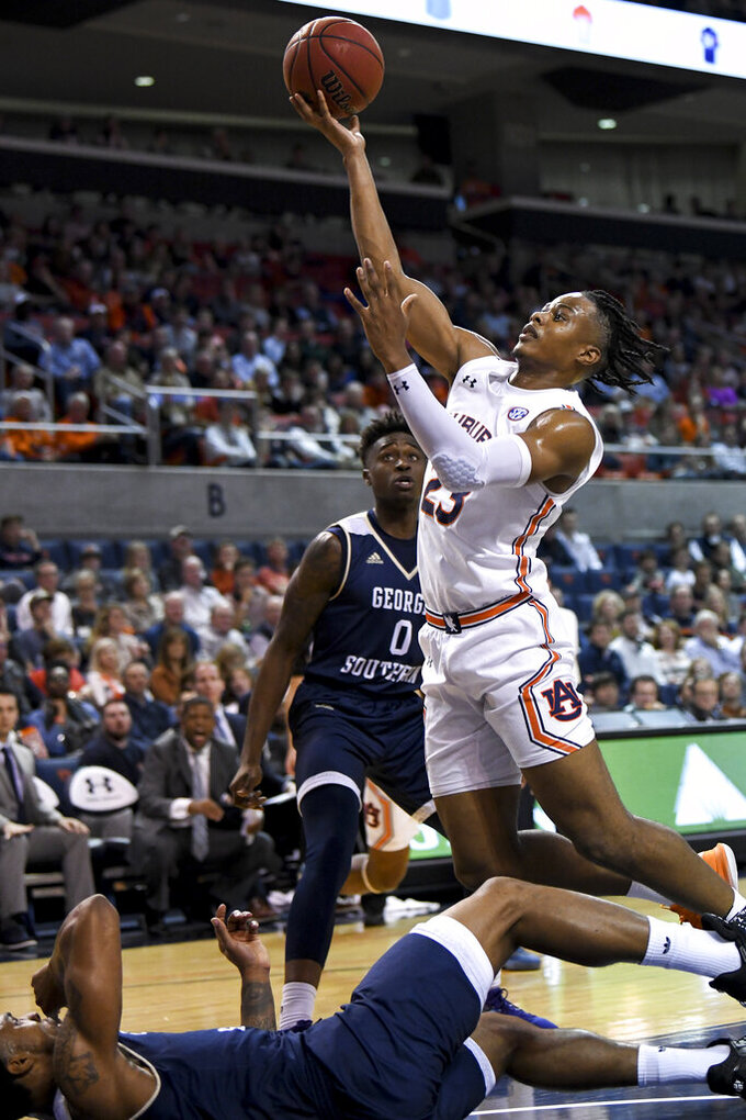 Auburn forward Isaac Okoro (23) runs over Georgia Southern guard Ike Smith (3) on the way to the basket during the first half of an NCAA college basketball game Tuesday, Nov. 5, 2019, in Auburn, Ala. (AP Photo/Julie Bennett)