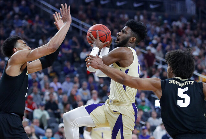 Colorado's Tyler Bey, left, and D'Shawn Schwartz, right, guard Washington's Jaylen Nowell during the second half of an NCAA college basketball game in the semifinals of the Pac-12 men's tournament Friday, March 15, 2019, in Las Vegas. (AP Photo/John Locher)