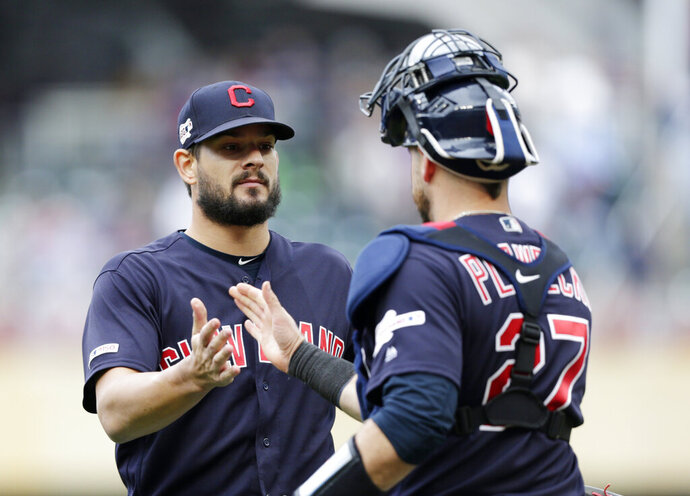 Cleveland Indians pitcher Brad Hand is congratulated by Indians catcher Kevin Plawecki (27) after the Indians defeated the Minnesota Twins 5-2 during a baseball game Sunday, Sept. 8, 2019 in Minneapolis. (AP Photo/Andy Clayton-King)