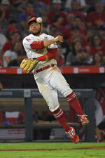 Los Angeles Angels third baseman David Fletcher throws out Boston Red Sox's Christian Vazquez at first during the sixth inning of a baseball game Friday, Aug. 30, 2019, in Anaheim, Calif. (AP Photo/Mark J. Terrill)