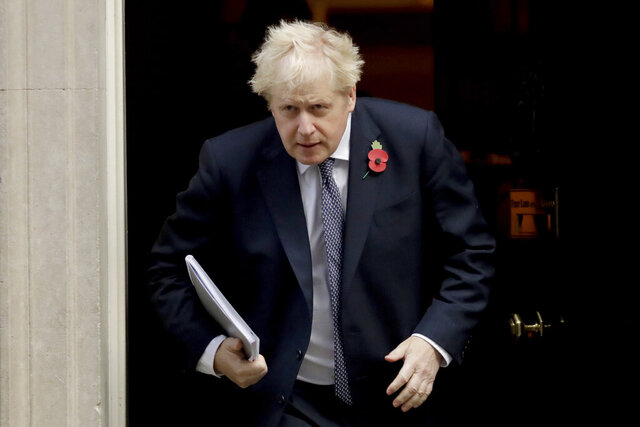 British Prime Minister Boris Johnson leaves 10 Downing Street in London, to attend a weekly cabinet meeting at the Foreign, Commonwealth & Development Office, in London, Tuesday, Nov. 10, 2020. (AP Photo/Matt Dunham)