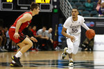 Washington guard Quade Green (55) brings the ball down the court as Ball State guard Luke Bumbalough (2) defends during the second half of an NCAA college basketball game, Sunday, Dec. 22, 2019, in Honolulu. (AP Photo/Marco Garcia)