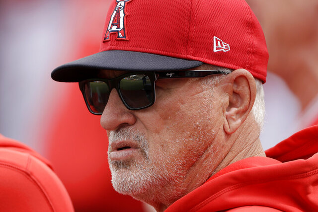 Los Angeles Angels manager Joe Maddon watches during the first inning of a spring training baseball game Friday, Feb. 28, 2020, in Tempe, Ariz. (AP Photo/Charlie Riedel)