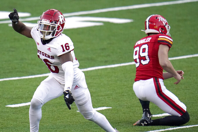 Rutgers' Max Melton (16) and Maryland holder Colton Spangler (99) react after place kicker Joseph Petrino missed a field goal during overtime of an NCAA college football game, Saturday, Dec. 12, 2020, in College Park, Md. Rutgers won 27-24 in overtime. (AP Photo/Julio Cortez)