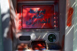 A damaged ATM screen has been spray painted with a message that reads in Arabic,