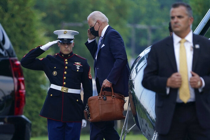 President Joe Biden walks off of Marine One at Walter Reed National Military Medical Center in Bethesda, Md., Thursday, July 29, 2021. Biden is there because first lady Jill Biden is having a procedure to remove an object that became lodged in her foot while walking on a Hawaiian beach earlier this week. (AP Photo/Susan Walsh)