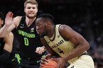 Oakland forward Daniel Oladapo (4) drives to the basket as Michigan State guard Kyle Ahrens (0) defends during the first half of an NCAA college basketball game, Saturday, Dec. 14, 2019, in Detroit. (AP Photo/Carlos Osorio)