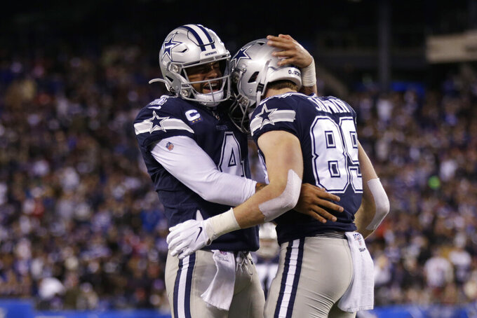 Dallas Cowboys quarterback Dak Prescott (4) celebrates with tight end Blake Jarwin (89) after Jarwin scored a touchdown against the New York Giants during the second quarter of an NFL football game, Monday, Nov. 4, 2019, in East Rutherford, N.J. (AP Photo/Adam Hunger)