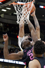 Minnesota's Jordan Murphy gets fouled by Penn State's Mike Watkins (24) during the first half of an NCAA college basketball game in the second round of the Big Ten Conference tournament, Thursday, March 14, 2019, in Chicago. (AP Photo/Kiichiro Sato)