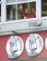 FILE - In this April 1, 2013, file photo, Cincinnati Reds broadcaster Marty Brennaman waves to the crowd during a baseball game against the Los Angeles Angels in Cincinnati. Brennaman is retiring after the 2019 season. (AP Photo/Michael Keating, File)