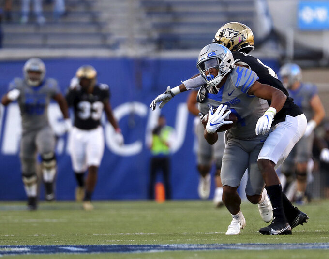 Memphis wide receiver Calivin Austin III (4) comes up after a catch against Central Florida during an NCAA college football game Saturday, Oct. 17, 2020, in Memphis, Tenn. (Patrick Lantrip/Daily Memphian via AP)