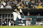 Chicago White Sox's Leury Garcia hits an RBI double off Pittsburgh Pirates relief pitcher Anthony Banda during the fifth inning of a baseball game Wednesday, Sept. 1, 2021, in Chicago. (AP Photo/Charles Rex Arbogast)