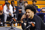 With his teammates looking on at rear, Cade Cunningham announces that he will enter the NBA draft after a dynamic freshman season that saw him named a first-team AP All-American, Thursday, April 1, 2021, in Stillwater, Okla. (AP Photo/Sue Ogrocki)