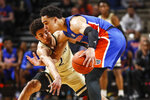 Vanderbilt guard Scotty Pippen Jr. (2) attempts to steal the ball from Florida guard Andrew Nembhard (2) during an NCAA college basketball game Saturday, Feb. 1, 2020, in Nashville, Tenn. (Wade Payne/The Tennessean via AP)