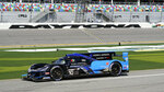 The Konica Minolta Acura DPi heads down pit road to take part in a practice session for the Rolex 24 hour race at Daytona International Speedway, Friday, Jan. 29, 2021, in Daytona Beach, Fla. (AP Photo/John Raoux)