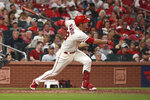 St. Louis Cardinals' Nolan Arenado watches his RBI-triple during the sixth inning of a baseball game against the Cincinnati Reds on Saturday, Sept. 11, 2021, in St. Louis. (AP Photo/Joe Puetz)