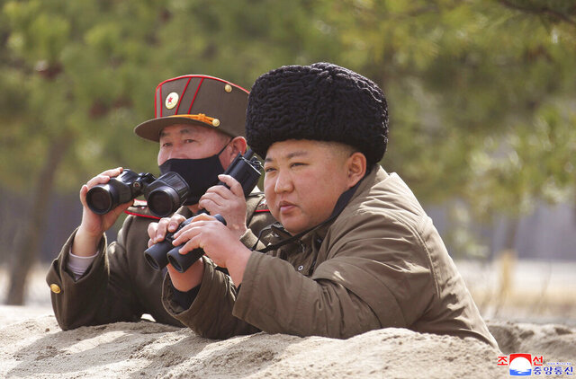 In this photo provided by the North Korean government, North Korean leader Kim Jong Un inspects a military drill at an undisclosed location in North Korea on Monday, March 9, 2020. Independent journalists were not given access to cover the event depicted in this image distributed by the North Korean government. The content of this image is as provided and cannot be independently verified. Korean language watermark on image as provided by source reads: