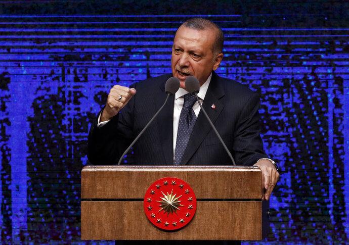 Turkey's President Recep Tayyip Erdogan announces plan of action for the first 100 days of his new presidency, in Ankara, Turkey, Friday, Aug. 3, 2018. (AP Photo/Burhan Ozbilici)