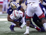 Washington linebacker Joe Tryon (9) sacks Utah quarterback Tyler Huntley (1) during the first half of an NCAA college football game, Saturday, Nov. 2, 2019, in Seattle. (AP Photo/Stephen Brashear)