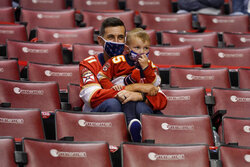 Florida Panthers fans watch in a socially distanced arena during the third period of an NHL hockey game against the Dallas Stars, Monday, Feb. 22, 2021, in Sunrise, Fla. The Panthers won 3-1. (AP Photo/Lynne Sladky)
