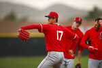 Los Angeles Angels' Shohei Ohtani (17) performs in a fielding practice drill during a spring training baseball practice on Wednesday, Feb. 14, 2018, in Tempe, Ariz. (AP Photo/Ben Margot)