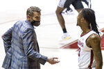 Alabama head coach Nate Oats talks with Alabama guard John Petty Jr. (23) during the second half of an NCAA college basketball game against Georgia on Saturday, Feb. 13, 2021, in Tuscaloosa, Ala. (AP Photo/Vasha Hunt)
