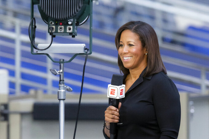 FILE - In this Oct. 19, 2020, file photo, ESPN reporter Lisa Salters stands by before an NFL football game between the Arizona Cardinals and Dallas Cowboys in Arlington, Texas. Despite last-minute schedule changes, pregame features being done remotely and announcers being separated by more than six feet and plexiglass, networks have been able to weather the challenges of airing games during a pandemic. (AP Photo/Brandon Wade, File)