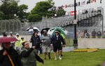 Spectators on Belle Isle were advised to exit the stands and seek shelter about 90 minutes before the scheduled start of the first race of IndyCar Detroit Grand Prix's auto racing doubleheader, Saturday, June 1, 2019, in Detroit. (AP Photo/Carlos Osorio)