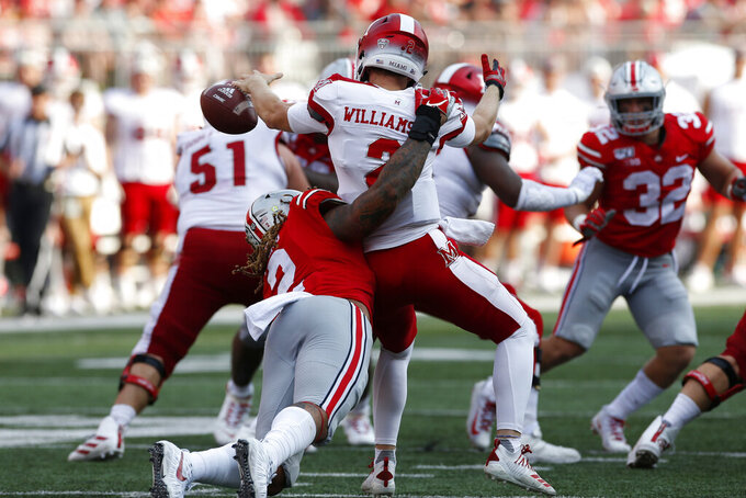FILE - In this Sept. 21, 2019, file photo, Ohio State defensive end Chase Young, left, sacks Miami (Ohio) quarterback Jackson Williamson causing a fumble during the first half of an NCAA college football game, in Columbus, Ohio. Ohio State said, Wednesday, Nov. 13, 2019, the NCAA has concluded that star DE Chase Young must sit out one more football game before he can return. (AP Photo/Jay LaPrete, File)