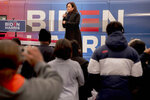 Senator Kamala Harris speaks to the crowd during a drive-in style campaign event for Democratic presidential candidate former Vice President Joe Biden on Sunday, Oct. 25, 2020, in Pontiac, Mich. (Nicole Hester/Ann Arbor News via AP)