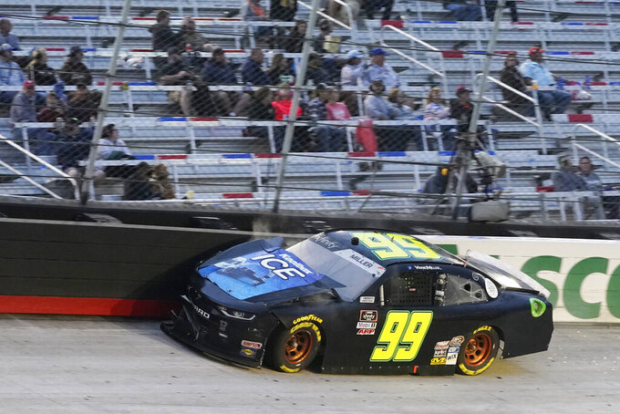Vinnie Miller (99) scrubs the wall in Turn 1 during the NASCAR Xfinity Series auto race Friday, Sept. 18, 2020, in Bristol, Tenn. (AP Photo/Steve Helber)