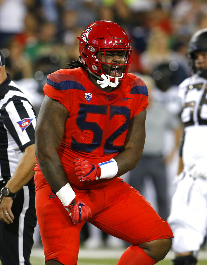 Arizona defensive tackle PJ Johnson (52) reacts after making a tackle for a loss against Oregon in the first half during an NCAA college football game, Saturday, Oct. 27, 2018, in Tucson, Ariz. (AP Photo/Rick Scuteri)