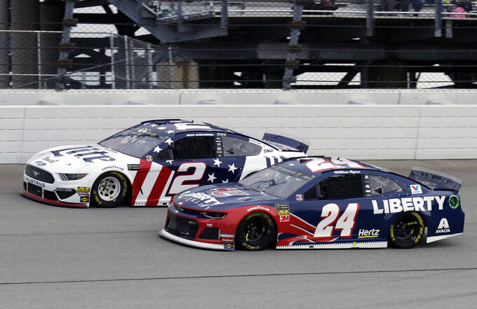 Brad Keselowski, left, and William Byron compete during a NASCAR Cup Series auto race at Chicagoland Speedway in Joliet, Ill., Sunday, June 30, 2019. (AP Photo/Nam Y. Huh)