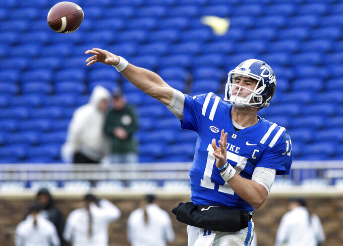 File-This Nov. 24, 2018 file photo shows Duke Quarterback Daniel Jones making a pass during the second half of an NCAA college football game in Durham, N.C. NFL scouts, coaches and prospects have gathered in Mobile, Alabama, for the Senior Bowl. The game for top senior NFL prospects and junior graduates will feature quarterbacks like Missouri's Drew Lock, West Virginia's Will Grier and Duke's Jones. (AP Photo/Ben McKeown, File)