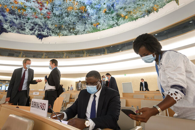 Delegates are seen prior to the vote at the United Nations Human Rights Council in Geneva, Switzerland, Friday, June 19, 2020. The U.N.'s top human rights body has voted unanimously to commission a U.N. report on systemic racism and discrimination against blacks. (Fabrice Coffrini/Pool Photo via AP)
