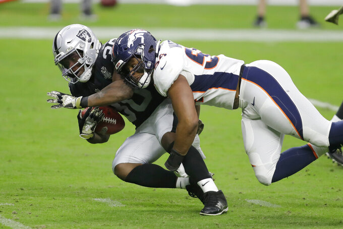 Denver Broncos linebacker Josh Watson (54) tackles Las Vegas Raiders running back Jalen Richard (30) during the first half of an NFL football game, Sunday, Nov. 15, 2020, in Las Vegas. (AP Photo/Isaac Brekken)