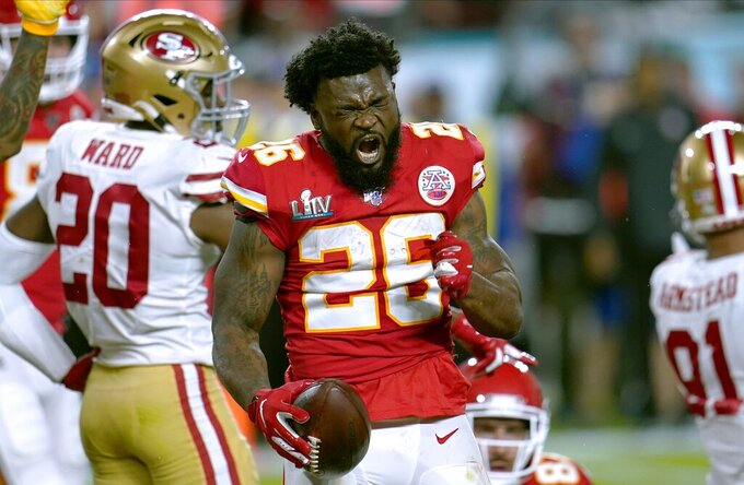 Kansas City Chiefs running back Damien Williams celebrates after a run against the San Francisco 49ers during the first half of the NFL Super Bowl 54 football game Sunday, Feb. 2, 2020, in Miami Gardens, Fla. (AP Photo/David J. Phillip)