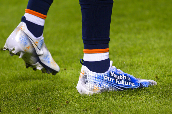 """Denver Broncos safety Justin Simmons wears his """"My Cause My Cleats"""" shoes during pre-game warmups before an NFL football game, Sunday, Dec. 6, 2020, in Kansas City, Mo. Five years ago, about 500 players participated in the inaugural campaign, marking the first time players could wear custom cleats during games without facing fines. This year, more than 1,000 players took part, wearing their cleats during Week 13 games to raise awareness and funds for various causes. (AP Photo/Reed Hoffmann)"""