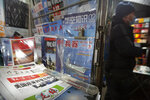 A copy of the Chinese state-run Global Times newspaper with a front page devoted to coverage of the inauguration of President Joe Biden is displayed at a newsstand in Beijing, Thursday, Jan. 21, 2021. China has expressed hope the Biden administration will improve prospects for people of both countries and give a boost to relations after an especially rocky patch, while getting in a few final digs at former Trump officials. (AP Photo/Mark Schiefelbein)